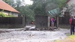 Torrent of water coming out at the speed of a local court after a heavy rain Stock Footage
