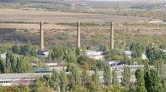 Chisinau industrial zone glass factory smokestacks Stock Footage