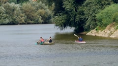 Group Rower rowing on the waters of a great river area gently flowing under a Stock Footage