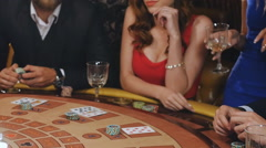 Girl won in blackjack and rejoice in victory, the guy lost and angry to lose Stock Footage