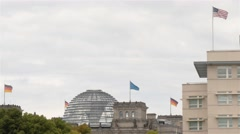 Real time locked down medium shot of Reichstag building and US Embassy in Berlin Stock Footage