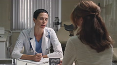 Woman Discussing Scan with Gynecologist Stock Footage