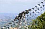 Thick steel cables and pulleys for the Transportation cableway in the mountai Stock Photos