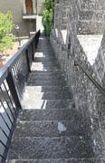 Long staircase leading down from the tower of the medieval castle in Europe Kuvituskuvat