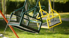 Empty swing on school playground Stock Footage
