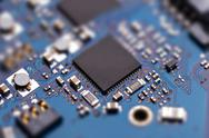 Microprochip on blue circuit board Stock Photos