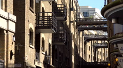 Great Britain England City of London old warehouses in Shad Thames near Bridge Stock Footage