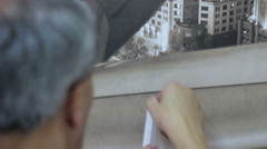 Worker remove bubbles after wallpapering with a syringe Stock Footage