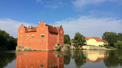 Cervena Lhota. Czech Republic. Castle on the lake and the flowing clouds. Time Stock Footage