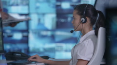 4K Security team having discussion in control room with multiple video screens Stock Footage