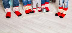Big family of father, mother, sister, brother and baby in Christmas socks Stock Photos