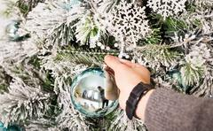 Man's hand with Christmas balls. Winter, party, New Year and Christmas concept Stock Photos