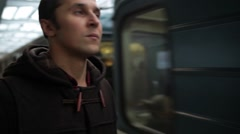 Young man waiting train in a subway station and comes in a wagon Stock Footage