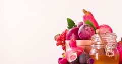 Still life fruit rotation 4k looped copy space video. Red Food basket on white Stock Footage