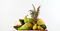 Still life fruit rotation 4k looped video. Tropical food basket white background Stock Footage