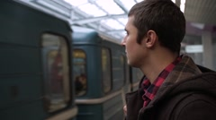 Young man waiting train in a subway station Stock Footage