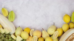 Yellow fruits stop motion animation copy space 4k intro video food background Stock Footage