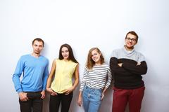 Friends posing white wall background Stock Photos