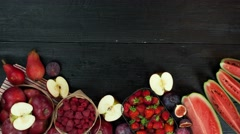 Fruits stop motion animation copy space 4k intro video food background black red Stock Footage