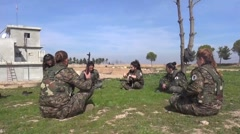 Syria - February 13, 2016: Troops sit on the ground, SDF-YPJ - Training camp Stock Footage