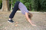 Yoga pose. Senior woman slim body make morning yoga Stock Photos
