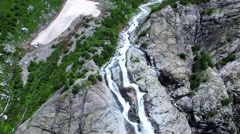 Aerial view of rocky mountains river and waterfall 4k nature video. Water flows Stock Footage