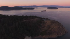 Beautiful Sunset Aerial of Cargo Ship in Puget Sound with Mount Baker Stock Footage