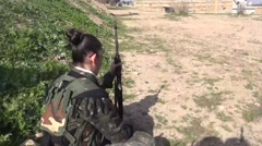 Syria - February 13, 2016: YPJ work and keep kalashnikov, SDF - Training camp Stock Footage