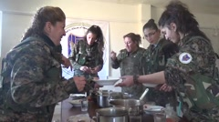 Syria - February 13, 2016: Women troops hand food, SDF-YPJ - Training camp Stock Footage