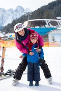 Beautiful young mom and her toddler boy, skiing in the mountains Stock Photos