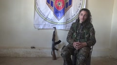 Syria - February 13, 2016: YPJ commander next to the flag, SDF - Training camp Stock Footage