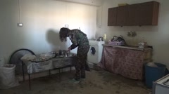 Syria - February 13, 2016: YPJ commander in the kitchen, SDF- Training camp Stock Footage
