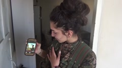 Syria - February 13, 2016:Women show video on her phone,SDF-YPJ-Training camp Stock Footage