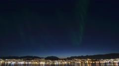 Aurora borealis over tromsoe city island at dawn with clear star sky timelapse Stock Footage