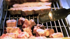 Slow motion of a Vendor cooking a beef meat with blowtorch in Night market-Dan Stock Footage