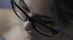Close-up portrait of woman with glasses Stock Footage