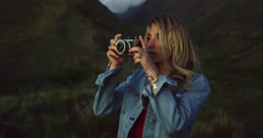 Young Woman with Vintage Camera Taking Pictures Stock Footage