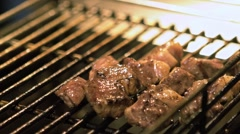 Slow motion of a Vendor cooking a beef meat on grill in Asian Night market-Dan Stock Footage