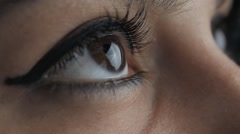 Close up big woman's brown eyes Stock Footage