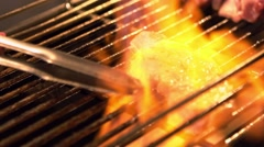 Slow motion of aVendor cooking a beef meat with blowtorch in Night market-Dan Stock Footage