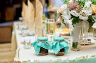 Wedding table decorated with flowers in restaurant Stock Photos