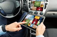 Close up of man with tablet pc in car Stock Photos
