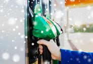 Close up of hand holding hose at gas station Stock Photos