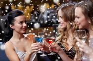 Happy women with drinks at night club Stock Photos