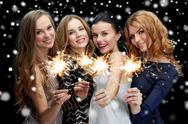 Happy young women dancing at night club disco Stock Photos