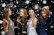 Happy young women dancing over snow Stock Photos