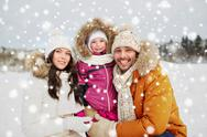 Happy family with child in winter clothes outdoors Stock Photos