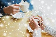Close up of couple drinking tea at cafe Stock Photos