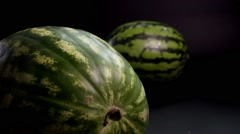 Watermelon slice rotation on a black background Stock Footage