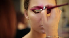 Make-up artist in the process of creating an image Stock Footage